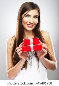 Happy woman holding red gift box. Christmas style present.