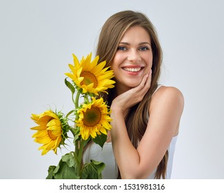 happy woman holding three sunflowers. girl with long hair.
