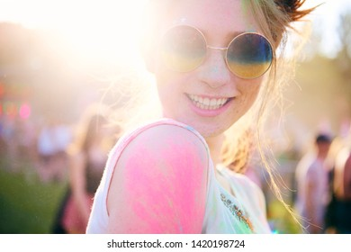 Happy woman in holi colors