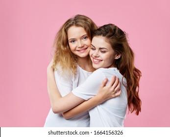 Happy woman hugs her little daughter