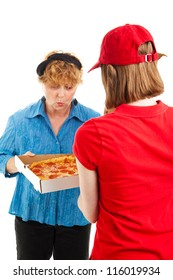 Happy woman inspects the pizza she's having delivered by a delivery girl.