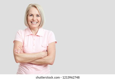 Happy woman isolated on grey background