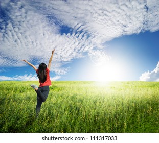 Happy woman jump in grass fields and blue sky