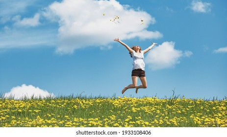 Happy woman jump for joy with laugh on nature spring. Woman power and freedom.