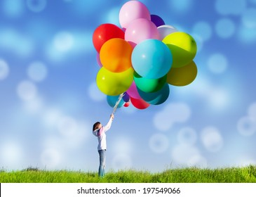 Happy woman jumping with balloons