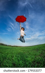 Happy woman jumping in spring field