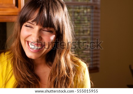 Happy woman laughing.