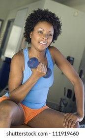 Happy woman lifting weights