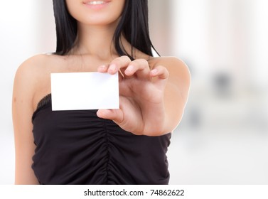 happy woman looking at a business card
