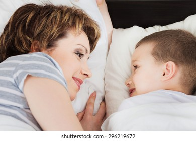 Happy woman looking at her son and smiling