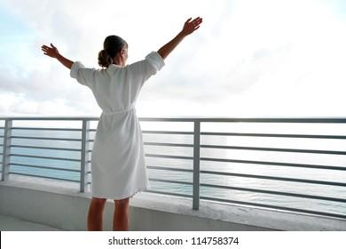 Happy woman looking on the ocean. Resort.
