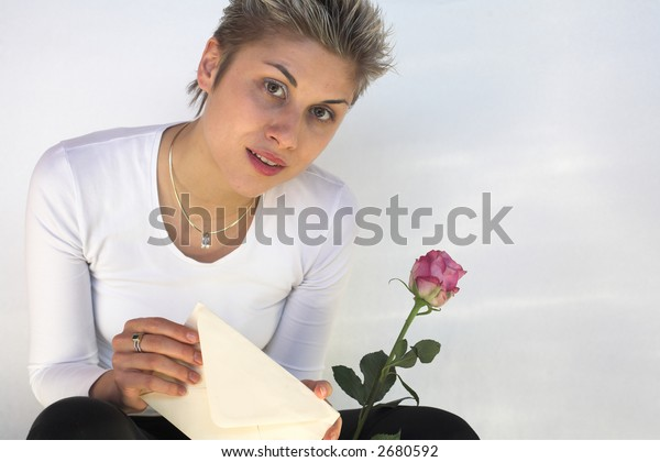 happy woman  with a love letter in hands, white background