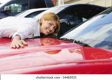 happy woman loves her  new sports car