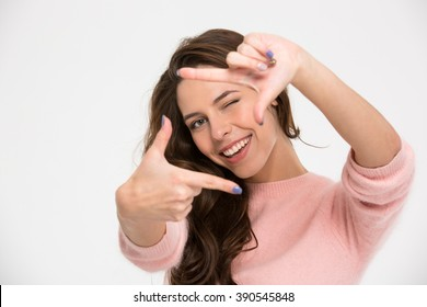 Happy woman making frame with fingers isolated on a white background