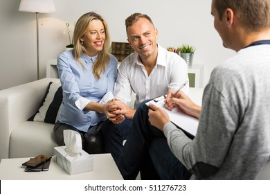 Happy woman and man at couples consultation