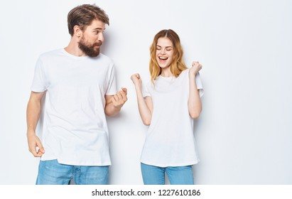 happy woman and man in white t-shirt