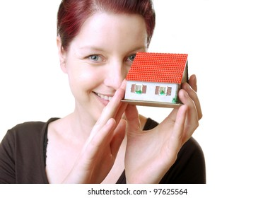 happy woman with miniature house