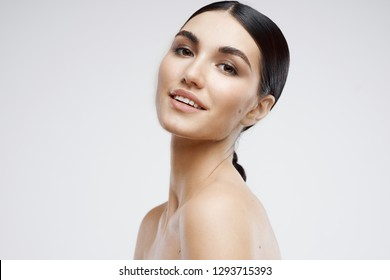Happy woman with moisturized skin beautiful face