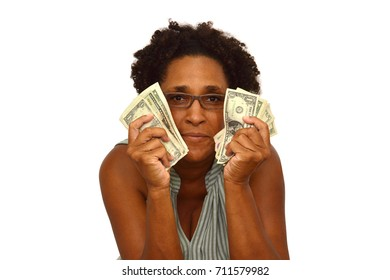 Happy woman with money looking at camera smiling white background