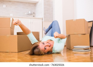 Happy woman moving into her new home.