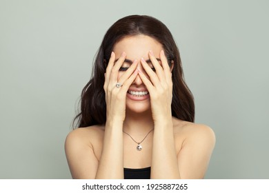 Happy woman in necklace and ring with diamond on white background