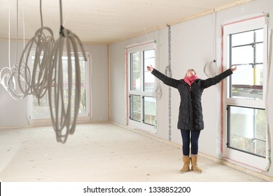 A Happy Woman in a new construction enjoying live