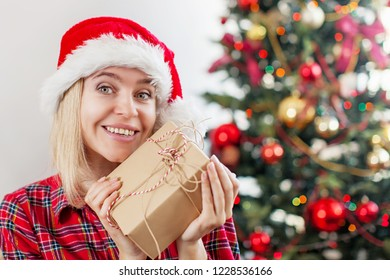 Happy woman on Christmas tree background