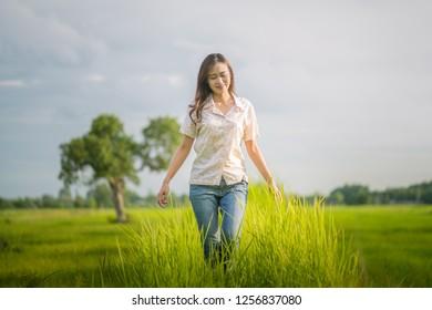 Happy woman on grass field