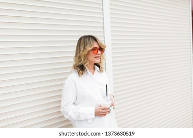 Happy woman on the street