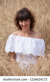 Happy woman on wheat field