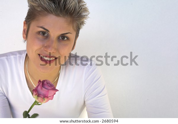 happy woman outdoor with a rose in hands, white background