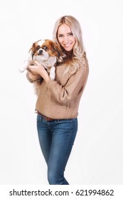 Happy woman with a Pekingese dog
