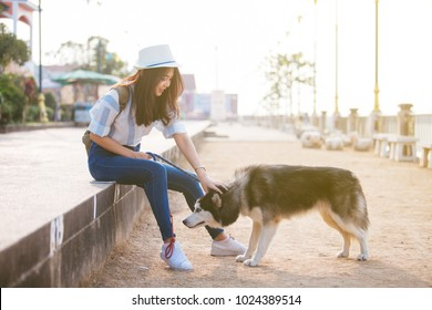 happy woman with pet dog outdoors