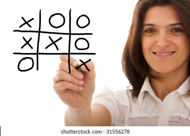 happy woman playing a leisure game on a whiteboard (selective focus)
