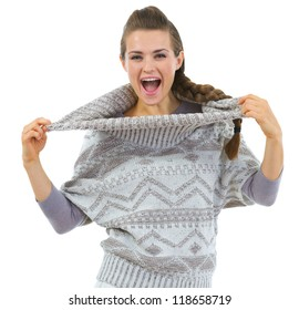 Happy woman playing with sweater collar