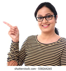 Happy woman pointing at copy space against white background
