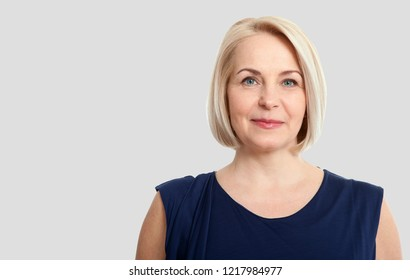 Happy woman portrait Isolated on grey background.