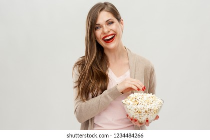 Happy woman portrait with popcorn glass bucket. Isolated female portrait on white.