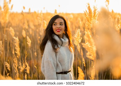happy woman posing on the nice sunset countryside