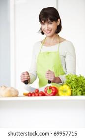 Happy Woman Preparing Meal