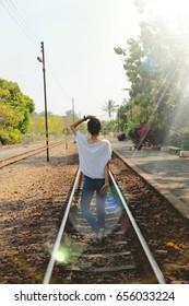 happy woman at railway