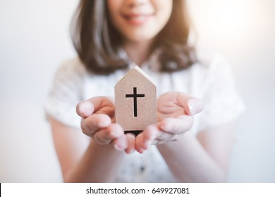 Happy woman ready to serving  god , Praying for God Religion ,Hands holding paper church close up