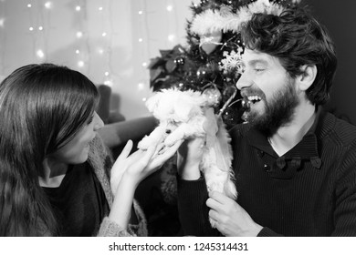Happy woman receiving a special gift at christmas