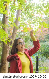 Happy woman relax travel in Japan. Smile and happy trip travel nature in Japan at Autumn.