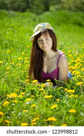 Happy   woman  relaxing outdoor in dandelion meadow