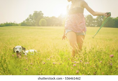 happy woman running with the dog in nature