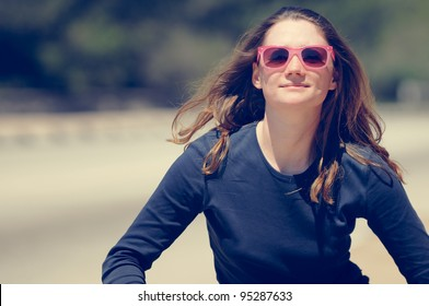 Happy Woman running in pink sunglasses