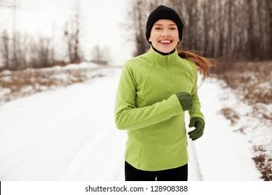 Happy woman running in winter