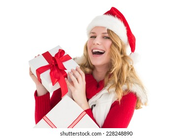 Happy woman in santa hat holding a gift on white background