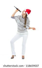 Happy woman in Santa hat singing in microphone